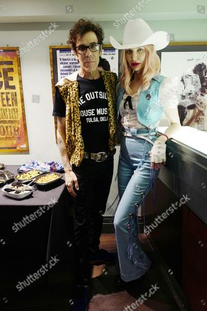 Slim Jim Phantom and girlfriend