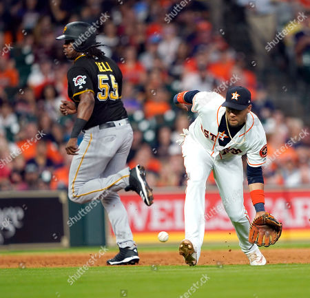 Houston Astros third baseman Yuli Gurriel, right, fields a ground ball by Pittsburgh Pirates' Elias Diaz as Josh Bell (55) advances from second to third during the third inning of a baseball game, in Houston. Diaz was out at first