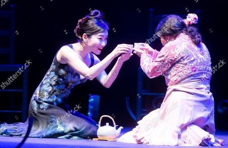 Stock Picture of Spanish choreographer and flamenco dancer Eva Yerbabuena (R) and Japanese artist Anna Sato (L) performs 'Cuentos de azucar' (Tales of Sugar) during the International Festival of Music and Dance of Granada at the Generalife Theatre in Granada, Spain, 26 June 2019.