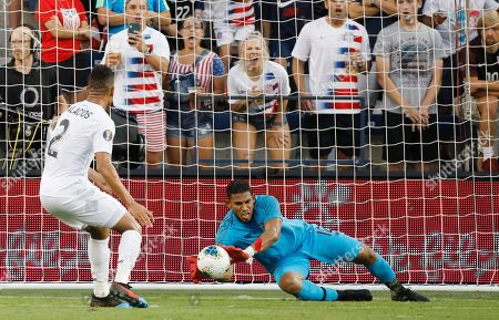 Panama goalkeeper Jose Calderon (12) blocks a shot against the United States as defender Francisco Palacios (2) watches during the first half of a CONCACAF Gold Cup soccer match in Kansas City, Kan