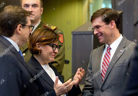 Stock Picture of U.S. Acting Secretary for Defense Mark Esper, right, speaks with Italian Defense Minister Elisabetta Trenta, third left, during a meeting of the North Atlantic Council in defense ministers session at NATO headquarters in Brussels