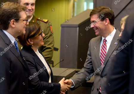 U.S. Acting Secretary for Defense Mark Esper, right, shakes hands with Italian Defense Minister Elisabetta Trenta, third left, during a meeting of the North Atlantic Council in defense ministers session at NATO headquarters in Brussels