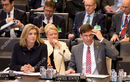 Acting U.S. Secretary for Defense Mark Esper, right, and British Defense Minister Penny Mordaunt, left, attend a meeting of the North Atlantic Council in defense ministers session at NATO headquarters in Brussels
