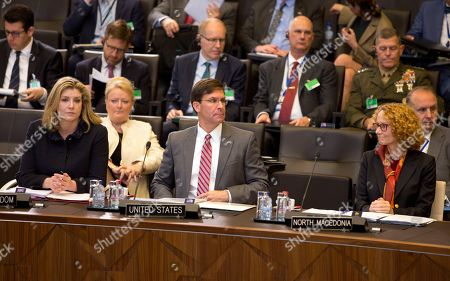 Acting U.S. Secretary for Defense Mark Esper, center, and British Defense Minister Penny Mordaunt, left, attend a meeting of the North Atlantic Council in defense ministers session at NATO headquarters in Brussels