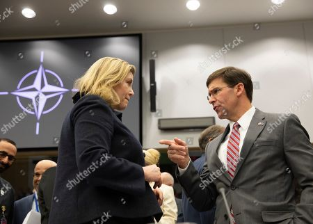 Acting U.S. Secretary for Defense Mark Esper, right, speaks with British Defense Minister Penny Mordaunt during a meeting of the North Atlantic Council with Resolute Support at NATO headquarters in Brussels