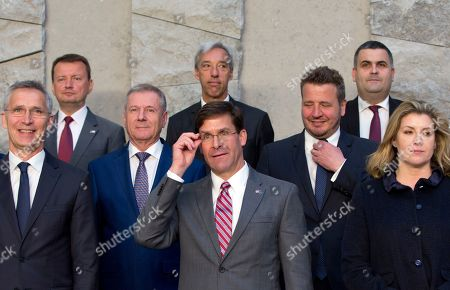 Acting U.S. Secretary for Defense Mark Esper, center front, poses with other ministers during a group photo of NATO defense ministers at NATO headquarters in Brussels, . At left front is NATO Secretary General Jens Stoltenberg and at right front is British Defense Minister Penny Mordaunt
