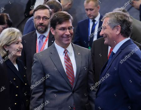 Stock Picture of Acting US Secretary for Defense Mark Esper (C), US Ambassador to NATO Kay Bailey (L) and Slovenia's Defense Minister Karl Erjavec at the start of a North Atlantic council meeting during NATO defense ministers meeting in Brussels, Belgium, 27 June 2019. NATO Defense ministers gather in Brussels on 26-27 June.