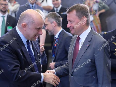 Stock Picture of Estonian Defense Minister Juri Luik (L) and Polish Defense Minister Mariusz Blaszczak at the start of a North Atlantic council meeting during NATO defense ministers meeting in Brussels, Belgium, 27 June 2019. NATO Defense ministers gather in Brussels on 26-27 June.