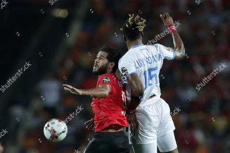 Egypt's Marwan Mohsen, left, jumps for the ball with DR Congo's Christian Luyidama Nekadio during the group A soccer match between Egypt and DR Congo at the Africa Cup of Nations at Cairo International Stadium in Cairo, Egypt