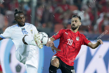 Egypt's Abdallah El Said, right, fights for the ball with DR Congo's Merveille Bokadi Bope during the group A soccer match between Egypt and DR Congo at the Africa Cup of Nations at Cairo International Stadium in Cairo, Egypt