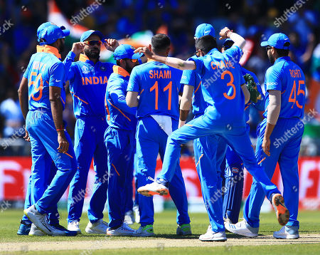 Kedar Jadhav of India celebrates taking a catch from Chris Gayle of West Indies with his team-mates