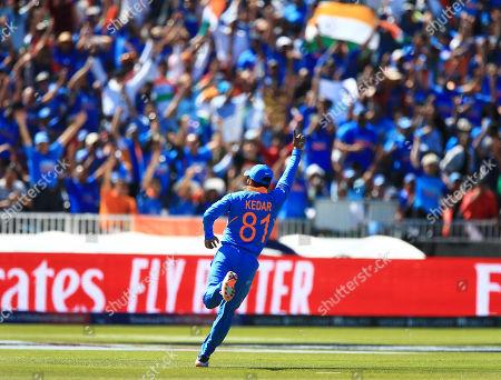 Kedar Jadhav of India celebrates taking a catch from Chris Gayle of West Indies