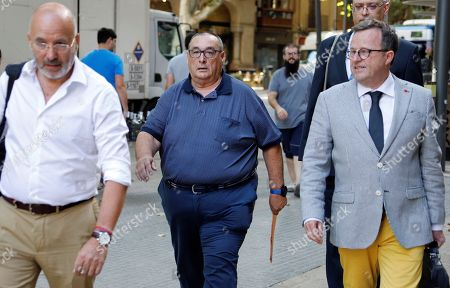 Stock Image of Santos Marquez (C), a sport agent who mediated in the transfer of Spanish goalkeeper Iker Casillas from Real Madrid to Porto FC, arrives at court to attend the first sesion of his trial for alleged unfair administration in Palma de Mallorca, Balearic Islands, eastern Spain, 27 June 2019.