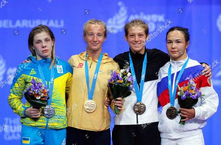 Stock Picture of (L-R) Silver medalist Yuliia Khavaldzhy of Ukraine, gold medalist Sofia Mattsson of Sweden, bronze medalists Nina Hemmer of Germany and Stalvira Orshush of Russia pose at the medal ceremony of the women's Wrestling Freestyle 53kg category in the Sports Palace at the Minsk 2019 European Games in Minsk, Belarus, 27 June 2019.