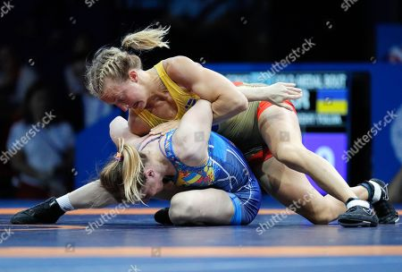 Yulia Khavaldzhy (blue) of Ukraine in action against Sofia Mattsson of Sweden during the gold medal bout of the women's Wrestling 53kg category in the Sports Palace at the Minsk 2019 European Games in Minsk, Belarus, 27 June 2019.