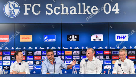New team coordinator Sascha Riether, new head coach David Wagner, sport board member Jochen Schneider and new technical director Michael Reschke, from left, talk to the media at a press conference of German Bundesliga traditional club FC Schalke 04 at the Veltins-Arena in Gelsenkirchen, Germany, . New head coach David Wagner was Premier League manager at Huddersfield until January