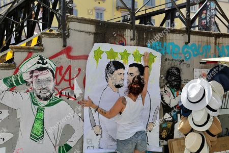 Stock Picture of New provocation on the canals of the artist Cristina Donati Meyer with a poster on the duel between the two exponents expounded Luigi Di Maio and Alessandro Di Battista
