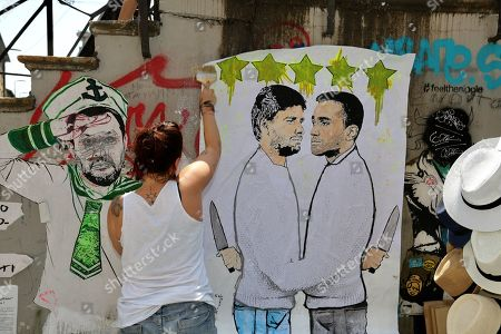 Stock Photo of New provocation on the canals of the artist Cristina Donati Meyer with a poster on the duel between the two exponents expounded Luigi Di Maio and Alessandro Di Battista