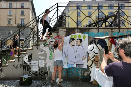 Stock Image of New provocation on the canals of the artist Cristina Donati Meyer with a poster on the duel between the two exponents expounded Luigi Di Maio and Alessandro Di Battista