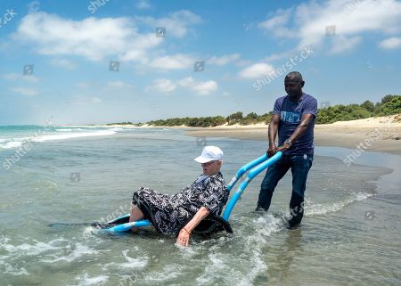 Segal (R), a care giver for Holocaust survivors helps Judith, a holocaust survivor in her eighties, enjoy the Mediterranean Sea during a visit of some 50 survivors living in the Lev HaSharon survivors residence to the beach at Kibbutz Ma'agan Micha'el, south of Haifa, Israel, 27 June 2019. Judith was a child in Hungary when the Nazis invaded in World War II. She lost all her family but managed to survive and at the close of the war had only the clothes on her back. She always had wanted to see the sea and today was the first time she was able to splash in the salt water.