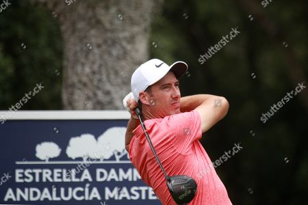 British golfer Ross Fisher tees off on the 7th hole during the Andalucia Masters at the Valderrama club golf course in San Roque, Spain, 27 June 2019.