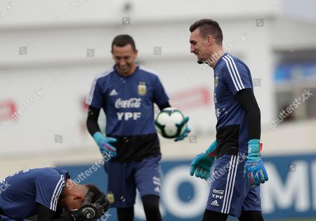 Argentina's goalkeeper Franco Armani, right, jokes with teammates during a practice session in Rio de Janeiro, Brazil, . Argentina will face Venezuela on June 28 in the quarterfinals for the Copa America