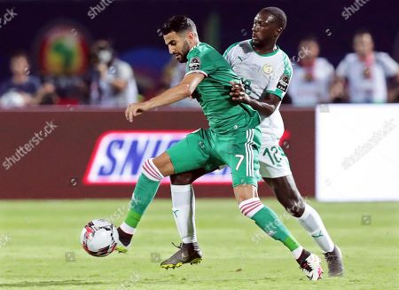 Senegal's Youssouf Sabaly (R) in action against Algeria's Riyad Mahrez (L) during the 2019 Africa Cup of Nations (AFCON) group C soccer match between Senegal and Algeria at 30 June Stadium in Cairo, Egypt, 27 June 2019.