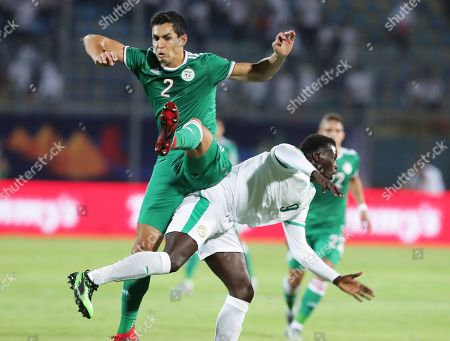 Senegal's M'Baye Niang (R) in action against Algeria's Aissa Mandi (L) during the 2019 Africa Cup of Nations (AFCON) group C soccer match between Senegal and Algeria at 30 June Stadium in Cairo, Egypt, 27 June 2019.