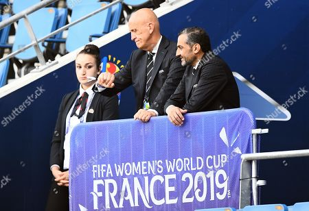 Chair of FIFA's refereeing committee Pierluigi Collina checks his watch in the stands before kick off