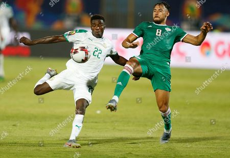 Senegal's Moussa Wague shoots by Algeria's Mohamed Belaili during the African Cup of Nations group C soccer match between Algeria and Senegal at 30 June Stadium in Cairo, Egypt
