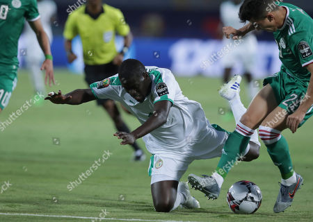 Senegal's Alfred Ndiaye is tackled by Algeria's Youcef Atal during the African Cup of Nations group C soccer match between Algeria and Senegal at 30 June Stadium in Cairo, Egypt