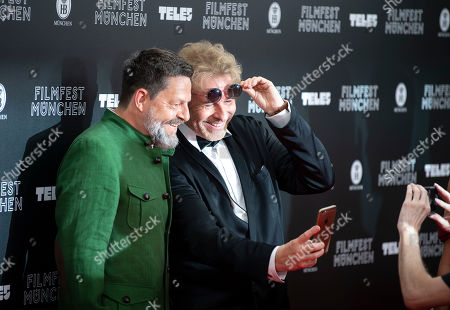 German TV presenter Thomas Gottschalk (R) and German media manager Kai Blasberg arrive for the Munich Filmfest Opening Night in Munich, Germany, 27 June 2019. Numerous national and international films will be shown at the festival until 06 July.