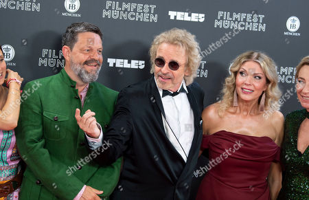 German TV presenter Thomas Gottschalk (C), companion Karina Mross (R) and German media manager Kai Blasberg (L) arrive for the Munich Filmfest Opening Night in Munich, Germany, 27 June 2019. Numerous national and international films will be shown at the festival until 06 July.