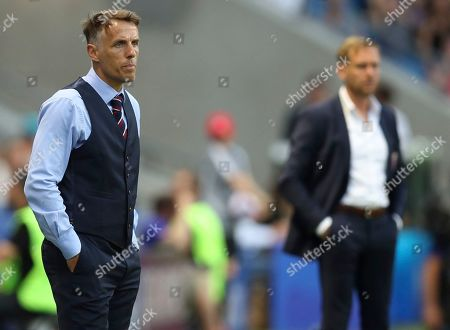 England head coach Philip Neville, left, and Norway coach Martin Sjogren, right, watch the Women's World Cup quarterfinal soccer match between Norway and England at the Oceane stadium in Le Havre, France
