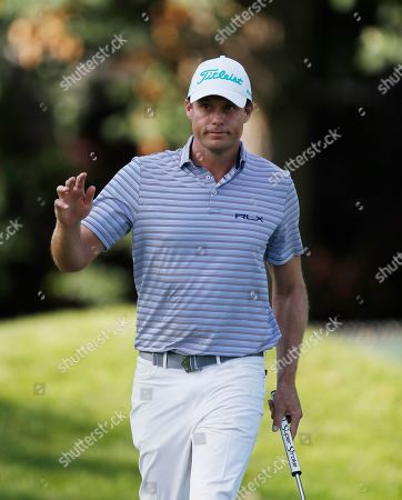 Nick Watney acknowledges the fans after his birdie on the ninth green during the first round of the Rocket Mortgage Classic golf tournament, in Detroit
