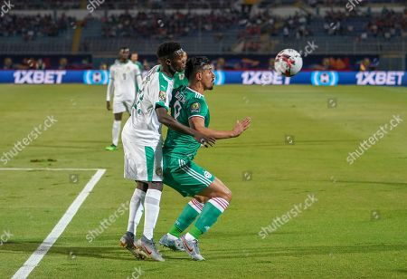 Baghdad Bounedjah of Algeria and Moussa Wague of Senegal challenging for the ball during the African Cup of Nations match between Senegal and Algeria at the 30 June Stadium in Cairo, Egypt