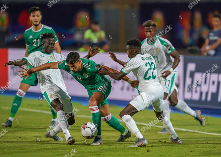 Mohamed Youcef Belaili of Algeria and Moussa Wague of Senegal challenging for the ball during the African Cup of Nations match between Senegal and Algeria at the 30 June Stadium in Cairo, Egypt