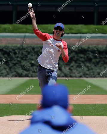 NASCAR driver Ryan Blaney throws out a ceremonial first pitch before a baseball game between the Atlanta Braves and the Chicago Cubs in Chicago
