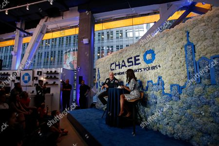 Stock Photo of Retired NASA Astronaut, Scott Kelly, speaks with Racquel Oden, Chase Northeast Divisional Director, at a Chase Chat at the bank's NYC Flagship branch on in New York