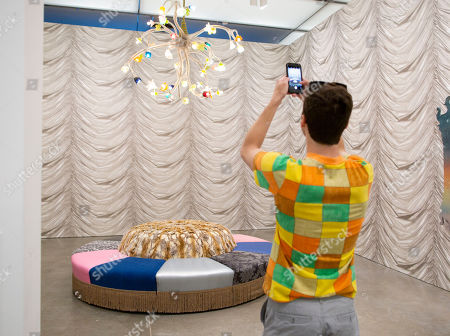 A visitor photographs the installation 'Doppelganger, 2017' and 'Large Chandelier (Hybrid), 2007' by United States artist Virgil Marti, as a part of the exhibition 'Less Is a Bore: Maximalist Art and Design', at the Institute of Contemporary Art in Boston, Massachusetts, USA, 27 June 2019. The exhibition features over 60 works by more than 40 artists, including artists Sol LeWitt and Jasper Johns.