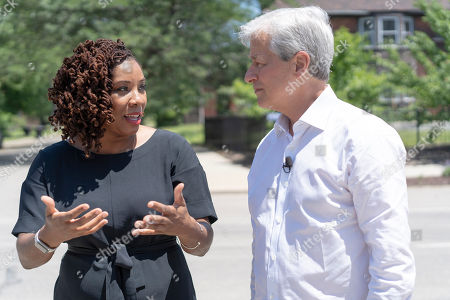 CO.- Detroit, MI: Develop Detroit CEO Sonya Mays, left, speaks with JPMorgan Chase Chairman and CEO Jamie Dimon, right, as she shows him around the North End neighborhood of Detroit on for the commemoration of JPMorgan Chase's $200 million investment in Detroit