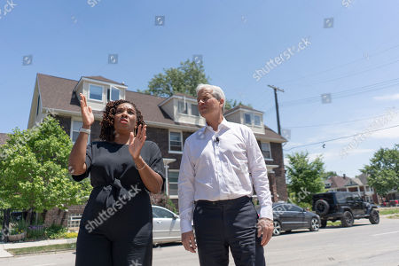 CO.- Detroit, MI: Develop Detroit CEO Sonya Mays, left, takes JPMorgan Chase Chairman and CEO Jamie Dimon on a short tour of the North End neighborhood in Detroit on for the commemoration of JPMorgan Chase's $200 million investment in Detroit