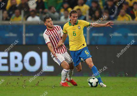 Brazil's Filipe Luis, right, and Paraguay's Richard Sanchez battle for the ball during a Copa America quarterfinal soccer match at the Arena do Gremio in Porto Alegre, Brazil