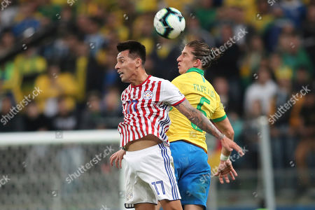 Brazil's Filipe Luis, heads the ball next to Paraguay's Hernan Perez during a Copa America quarterfinal soccer match at the Arena do Gremio in Porto Alegre, Brazil