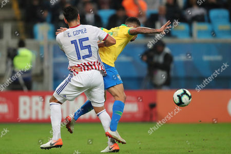 Stock Photo of Paraguay's Gustavo Gomez, left, pressures Brazil's Gabriel Jesus during a Copa America quarterfinal soccer match at the Arena do Gremio in Porto Alegre, Brazil