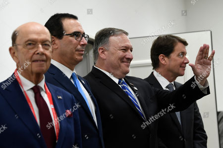 Wilbur Ross, Steven Mnuchin, Mike Pompeo, William Hagerty. Secretary of State Mike Pompeo, second from right, waves to the Indian delegation before the start of a meeting with President Donald Trump, Japanese Prime Minister Shinzo Abe, and Indian Prime Minister Narendra Modi, on the sidelines of the G-20 summit in Osaka, Japan, . Pompeo is joined by, from left, Commerce Secretary Wilbur Ross, Treasury Secretary Steven Mnuchin and U.S. Ambassador to Japan William Hagerty