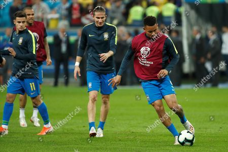 Brazilian players Philippe Coutinho (L) and Filipe Luis (C) prior the Copa America 2019 quarter-finals soccer match between Brazil and Paraguay, at Arena do Gremio Stadium in Porto Alegre, Brazil, 27 June 2019.