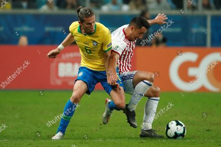 Paraguayan Ivan Piris (R) vies for the ball with Brazilian Filipe Luis (L) during the Copa America 2019 quarter-finals soccer match between Brazil and Paraguay at Arena do Gremio Stadium in Porto Alegre, Brazil, 27 June 2019.