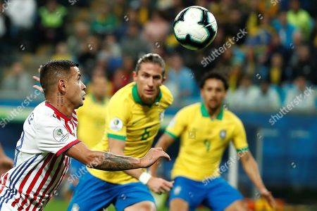 Paraguayan Derlis Gonzalez (L) in action against Brazilian Filipe Luis (C) during the Copa America 2019 quarter-finals soccer match between Brazil and Paraguay at Arena do Gremio Stadium in Porto Alegre, Brazil, 27 June 2019.