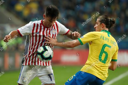 Brazilian Filipe Luis (R) vies for the ball with Paraguayan Hernan Perez (L) during the Copa America 2019 quarter-finals soccer match between Brazil and Paraguay at Arena do Gremio Stadium in Porto Alegre, Brazil, 27 June 2019.